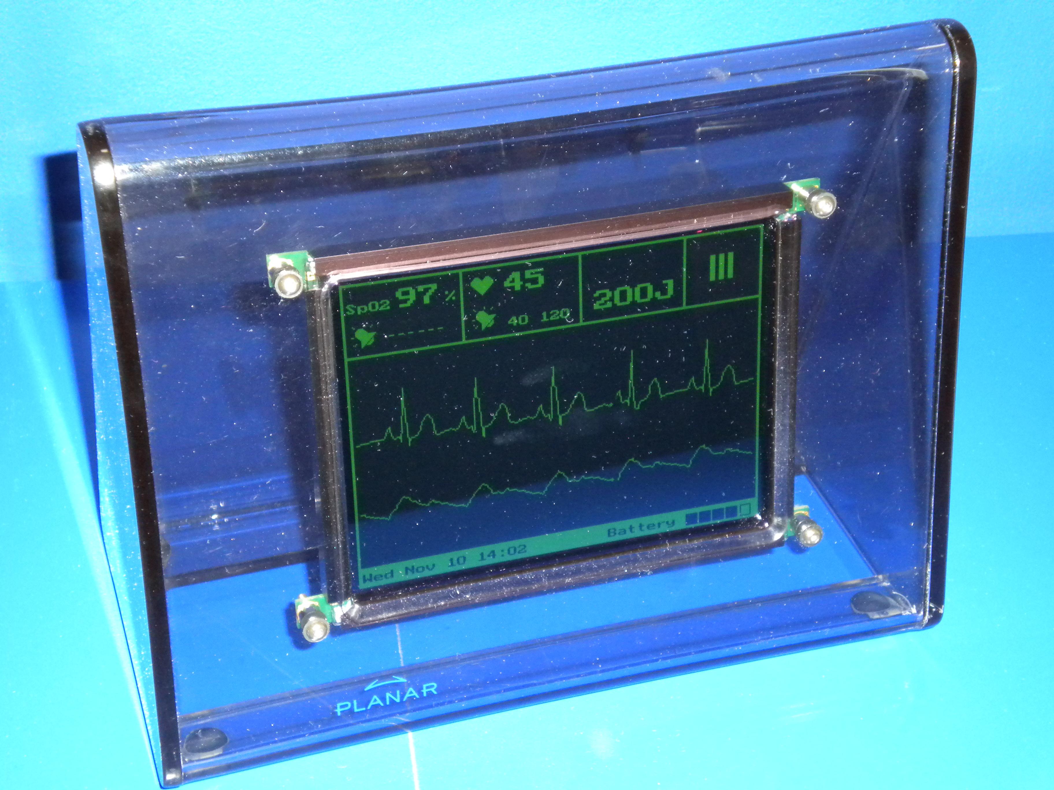 Электролюминесцентный монохромный дисплей с изображением зелёного цвета